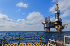 Offshore Jack Up Drilling Rig Over The Production Platform Stock Image