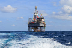 Offshore Jack Up Drilling Rig Over The Production Platform in Th Royalty Free Stock Photos
