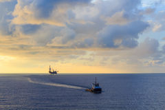 Offshore jack up drilling rig and supply boat Stock Image