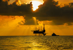 Offshore Jack Up Rig in The Middle of The Sea at Sunset Time stock photo