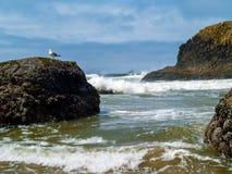 Offshore lighthouse on the Oregon Coast Royalty Free Stock Photos