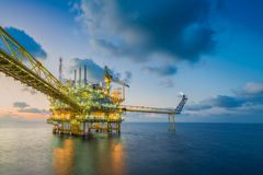 Offshore oil and gas business , Central processing platform received raw gas from wellhead remote platform stock photos