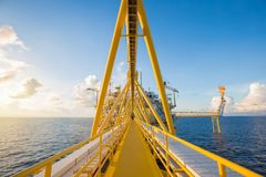 Offshore oil and gas central processing platform and flare platform while flaring. Royalty Free Stock Photo