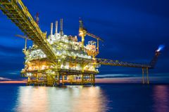 Offshore oil and gas central processing platform in sun set. Offshore oil and gas central processing platform treat raw gas and sent to onshore refinery and stock photos