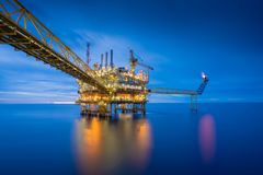 Offshore oil and gas central processing platform in sun set. Royalty Free Stock Image