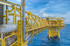 Offshore oil and gas construction platform in operation produce raw product for sent to onshore refinery stock photo