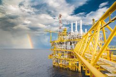 Offshore oil and gas construction platform in rain clouds. stock images