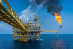 Offshore oil and gas construction platform while vent gases to flare platform to prevent over pressure from process upset. stock photos