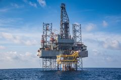 Offshore oil and gas drilling rig at the gulf of Thailand whil compleation on wellhead remote platform.  stock images