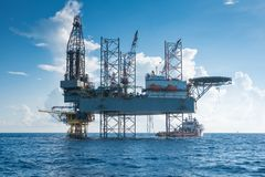 Offshore oil and gas drilling rig work over wellhead remote platform to compleation gases well. Offshore oil and gas drilling rig working on new wellhead remote Stock Photo