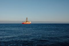 Offshore oil and gas drillship. Blue ocean background stock image