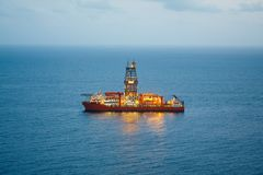 Offshore oil and gas drillship with illumination Royalty Free Stock Images