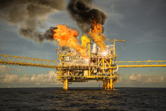 Offshore oil and gas fire case or emergency case, firefighter operation to control fire on oil and gas production platform. Offshore worst case and can't stock images