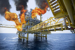 Offshore oil and gas fire case or emergency case, firefighter operation to control fire on oil and gas production platform Royalty Free Stock Image
