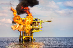 Offshore Oil and Gas Fire Case or Emergency Case, Firefighter Operation to Control Fire on Oil and Gas Production Platform Royalty Free Stock Photography