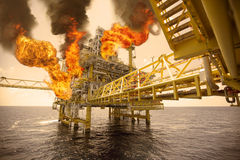 Offshore oil and gas fire case or emergency case in warm picture style, firefighter operation to control fire on oil and gas Stock Photos