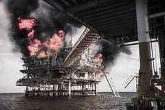 Offshore oil and gas fire case or emergency case in warm picture style, firefighter operation to control fire on oil and gas Stock Photography