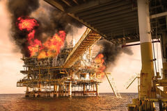 Offshore oil and gas fire case or emergency case in warm picture style, firefighter operation to control fire on oil and gas Stock Image