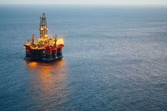Offshore oil and gas platform with illumination Royalty Free Stock Images