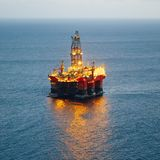 Offshore oil and gas platform with illumination Royalty Free Stock Photo
