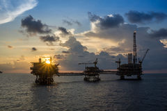 Offshore Oil and Gas Platform. Offshore oil and gas production platform during sunset Stock Photography