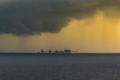 Offshore oil and gas platform. In storm stock image