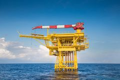 Offshore oil and gas industry produced raw gas and crude then sent to onshore refinery. Stock Photography