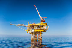 Offshore oil and gas production and exploration wellhead remote platform. Petrolium industry,Oil and Gas Wellhead Remote Platform, Produced gas and croud oil for Royalty Free Stock Photos