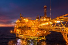 Offshore oil and gas rig platform with beautiful sunset time or stock photography