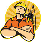Offshore Oil and Gas Worker Rig Retro. Illustration of an offshore oil and gas worker with arms crossed looking up with oil rig in background set inside circle Royalty Free Stock Images