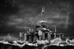 Offshore Oil Platform during strong storm in the middle of a sea. Offshore Oil Platform standing in the middle of ocean sea water during dark heavy rainy day Stock Photo