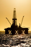 Offshore oil rig. Offshore drilling rig, during sunset. Coast of Brazil, 2011 Stock Images