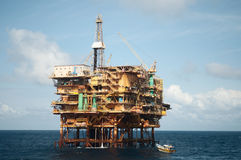Offshore  oil rig with fishing boat. Stock Photo