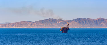 Offshore oil rig with flame Stock Photos