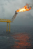 Offshore oil rig. Flare boom nozzle and fire on offshore oil rig Stock Photography
