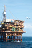 Offshore  oil rig with helicopter Stock Photo