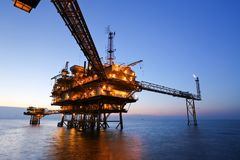 Offshore Oil Rig in The Middle of The Sea. Oil rig with beautiful blue sky background Stock Image