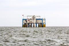 Offshore oil rig near Harlingen, Nederlande. HARLINGEN, NEDERLANDE - AUG 10, 2014: offshore oil rig near Harlingen, Nederlande. Oil producing is a major economic Stock Images