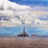 Offshore oil rig platform at sea petroleum industry Stock Images