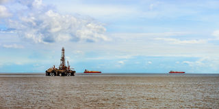 Offshore oil rig platform at sea petroleum industry Stock Photography