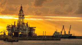 Offshore oil rig at sunset Royalty Free Stock Image
