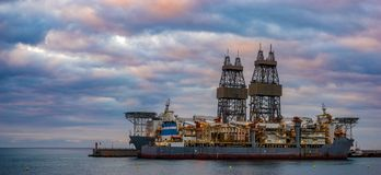 Offshore oil rig at sunset Stock Image