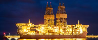 Offshore oil rig at sunset Stock Photos
