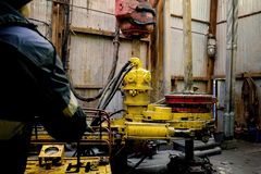 Offshore oil rig worker prepare tool and equipment for perforation oil and gas well at wellhead platform. Making up a drill pipe stock photos