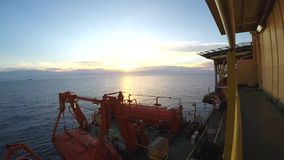 Offshore oilfield sunset time lapse from fwd of accomodation stock video footage