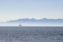 Offshore oilrig. An off-shore oil platform on the pacific coast, off California Stock Photography