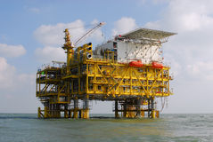 OFFSHORE PLATFORMS. Grand OFFSHORE Oil PLATFORMS in blue sky and white cloud, Bo Hai of China Stock Photo