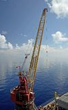 Offshore Rig Crane. An offshore Rig Crane sits idle between jobs Royalty Free Stock Photos