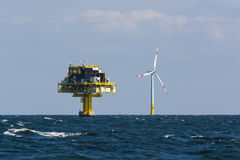Offshore substation and wind turbine Royalty Free Stock Images