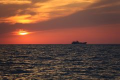 Offshore sunset royalty free stock photography